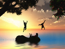 Happy childhood. Three kids bathing in the see at sunset Stock Photo