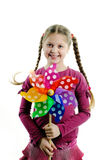 Happy childhood. An image of a happy girl with a whirligig in her hands stock photography