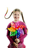 Happy childhood. An image of a happy girl with a whirligig in her hands royalty free stock photography