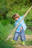 Happy childhood. Adventure hunting for treasures. Little helper working in garden. Cute child in nature having fun with. Shovel. I want to find treasures stock photography