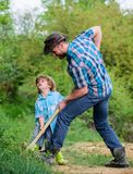 Happy childhood. Adventure hunting for treasures. Little helper working in garden. Cute child in nature having fun with. Shovel. Find treasures. Little boy and royalty free stock photography