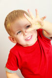 Happy childhood. Boy child kid showing painted palm. At home. Happy childhood. Portrait of smiling boy child kid preschooler showing painted hand palm. Creative royalty free stock photography