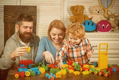 Happy childhood. Care and development. Little boy with dad and mom. little boy play with parents at home. father and. Mother with child play constructor. happy royalty free stock photography