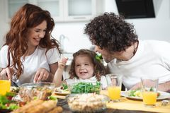 Friendly family having funny lunch together at home royalty free stock photography