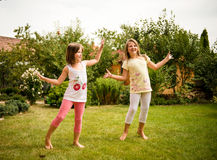 Happy childhood - dancing children Stock Image
