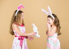 Happy childhood. Easter day. Easter activities for children. Happy easter. Holiday bunny girls with long bunny ears. Children bunny costume. Playful girls stock photo