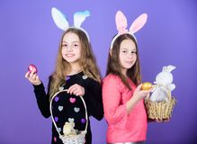 Happy childhood. Easter day. Easter activities for children. Happy easter. Holiday bunny girls with long bunny ears. Egg. And bunny holiday attribute. Sisters stock photography