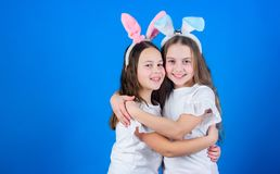 Happy childhood. Friendship concept. Easter vibes. Happy easter. Holiday bunny girls with long bunny ears hug. Children stock photos