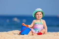 Happy childhood, happy family vacation. Cute child on the sea stock image