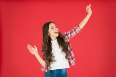 Happy childhood. Kid fashion. Little girl with beautiful long hair. Childrens day. Happy little girl on red background royalty free stock photos