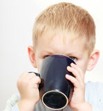 Happy childhood. Little boy kid child drinking tea Royalty Free Stock Photos