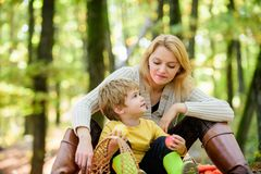 Happy childhood. Mom and kid boy relaxing while hiking forest. Family picnic. Mother pretty woman and little son stock image