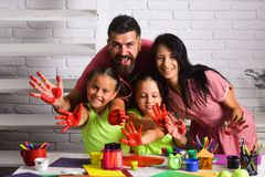 Happy childhood and parenting. Imagination, creativity concept. Girls drawing with mother and father. Children playing and learning with parents. Finger stock images