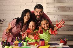 Happy childhood and parenting. Imagination, creativity concept. Girls drawing with mother and father. Children playing and learning with parents. Finger stock photography
