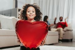 Smiling child showing toy heart Royalty Free Stock Photos