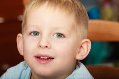 Happy childhood. Portrait of happy smiling blond boy child kid Royalty Free Stock Photo
