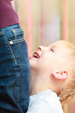 Happy childhood. Portrait of smiling boy kid hugging leg mother. Royalty Free Stock Photos