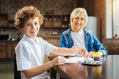 Cute boy painting with granny at home Stock Photos