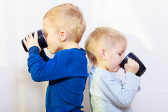 Happy childhood. Two brothers little boys drinking tea Stock Photo