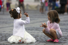 Happy childhood. Two pretty girls are playing innocently outdoor Royalty Free Stock Photography