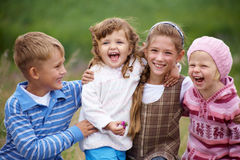 Happy children. Portrait of a group of children happily laughing and playing on the grass Royalty Free Stock Photos
