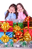 Happy children. Two little girls with a gift boxes. isolated on white Royalty Free Stock Photography