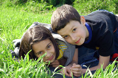 Happy children. Two happy children in grass royalty free stock images