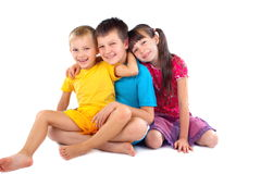 Happy children. In colorful outfits posing for camera Royalty Free Stock Photos