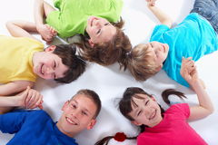 Happy Children. Group of smiling children holding hands Stock Photo