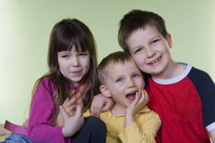 Happy children. Sister and brothers royalty free stock photography