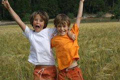 Happy children. Happy smiling children celebrating victory Stock Images
