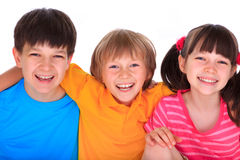 Happy children. Studio portrait of three smiling children, two boys and one girl.  Isolated on a white background Royalty Free Stock Image