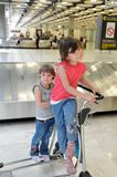 Happy children in airport royalty free stock image