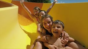 Free Happy Children Are Riding Down A Slide In Aquapark Royalty Free Stock Photography - 167694847