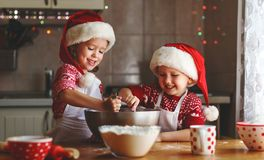 Happy children bake christmas cookies Royalty Free Stock Image