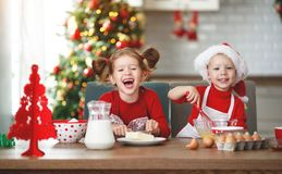 Happy children bake christmas cookies stock photography