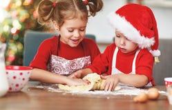 Happy children bake christmas cookies. Happy funny children bake christmas cookies stock photography