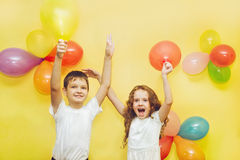 Happy children with balloons at birthday party. Stock Images