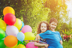 Happy children with balloons at summer park. Happy family concep Stock Photography