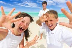 Happy children on beach stock photos