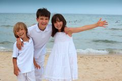 Happy children on beach royalty free stock photography