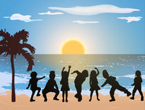 Happy children on the beach. Together Stock Images