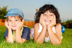 Happy children on beautiful green meadow royalty free stock photography