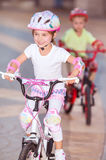 Happy children on bicycles Royalty Free Stock Photo