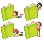 Happy children with big green book Stock Photos