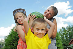 Happy children with a big watermelon Royalty Free Stock Photos