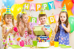 Happy children on birthday holiday stock images