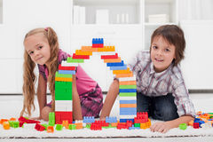 Happy children with blocks Royalty Free Stock Photo
