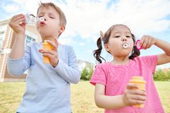 Happy Children Blowing Bubbles royalty free stock photo