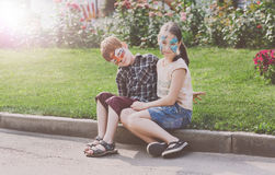 Happy children, boy and girl with face paint in park royalty free stock images